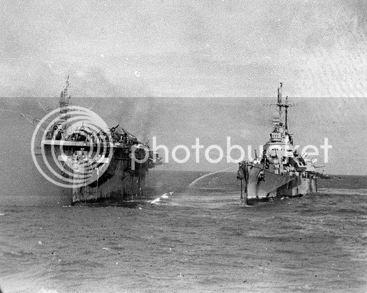 USS_Birmingham_comes_alongside_the_burni