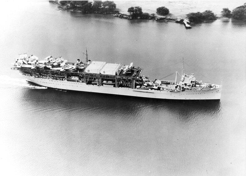 US Navy seaplane tender USS Langley (AV-3) is loaded with ...