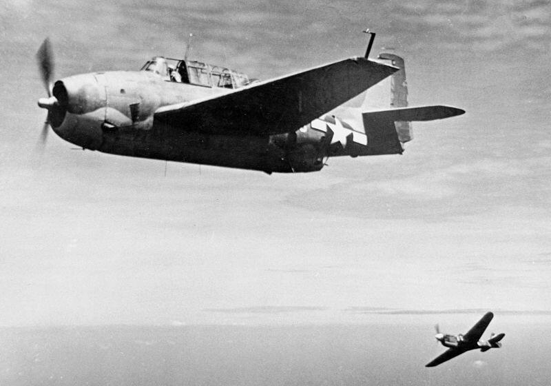 File:USMC TBF and RNZAF P-40 over Espiritu Santo c1944.jpeg